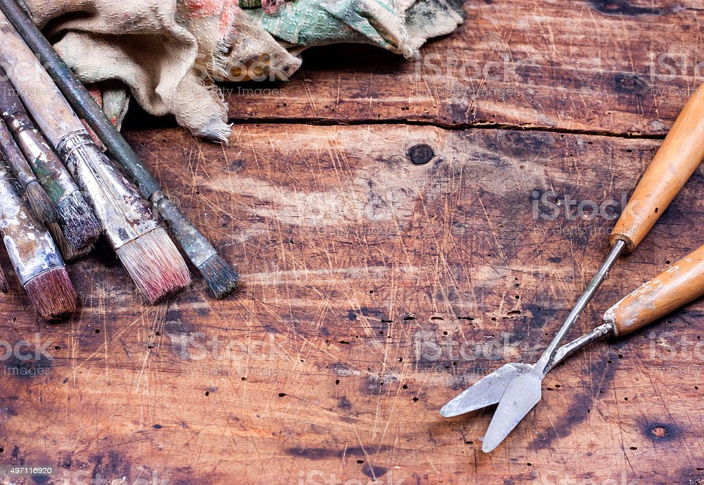 Paint brushes on wooden table stock photo