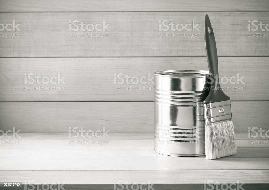 paint bucket and paintbrush  on wood stock photo
