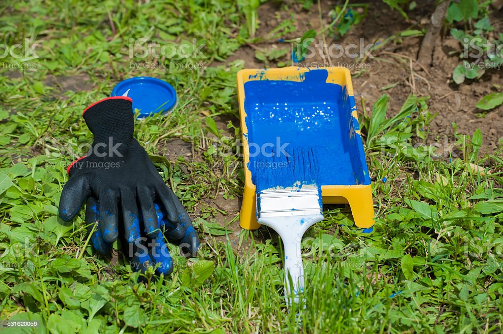 paint bucket and paintbrush with gloves stock photo