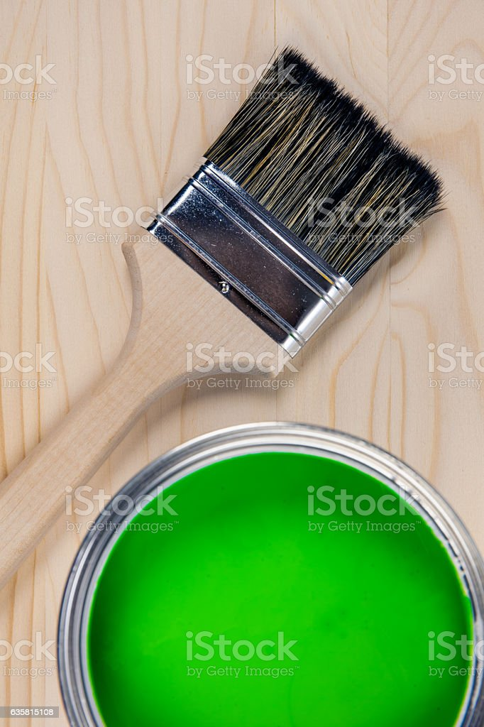 Paint bucket on a wooden background stock photo