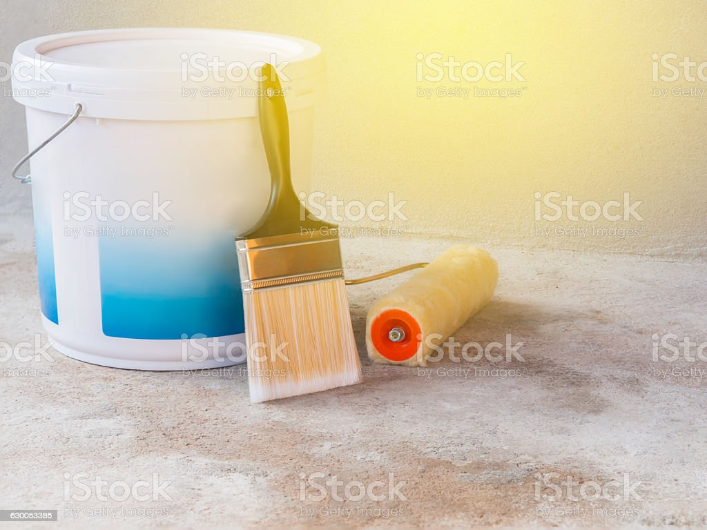 paint bucket, Paint roller and brush Placed on cement floor. stock photo
