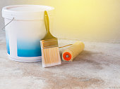 paint bucket, Paint roller and brush Placed on cement floor.