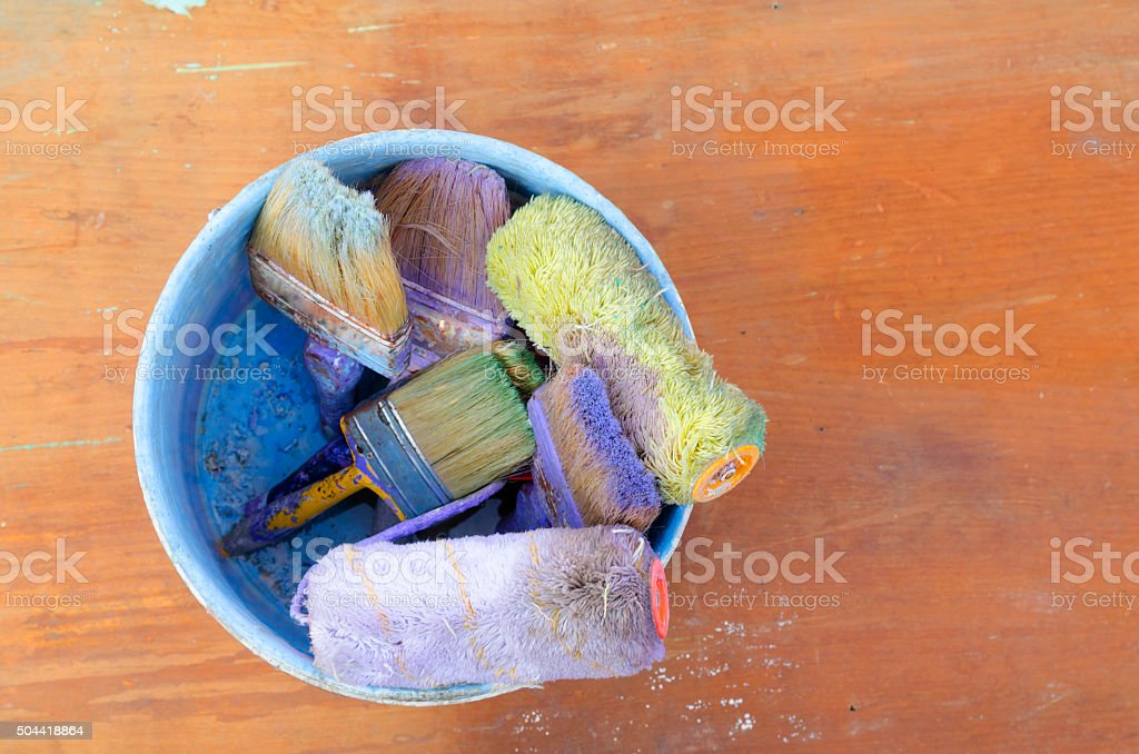 Paint bucket with brushes stock photo