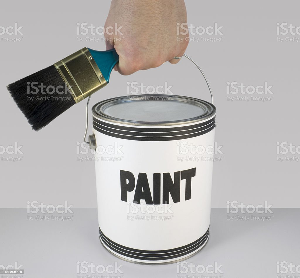 paint - can and brush in hand stock photo