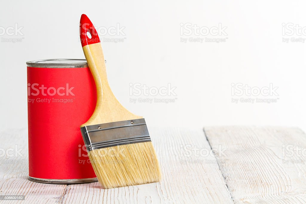 Paint Can Brush, Lacquer Wood Floor White Wall stock photo