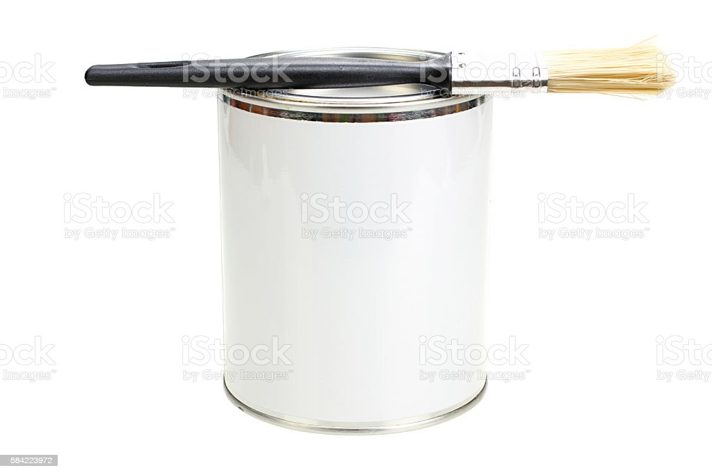 Paint can with blank white label and paintbrush isolated closeup stock photo