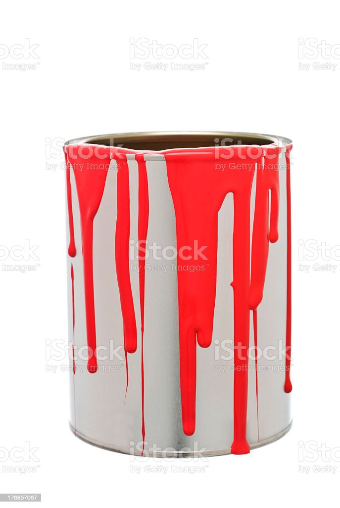 Paint can with red paint spilling over sides on white back stock photo
