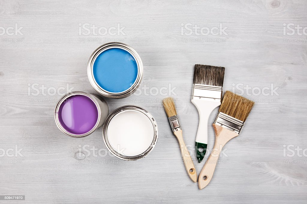 Paint cans and brushes on white background stock photo