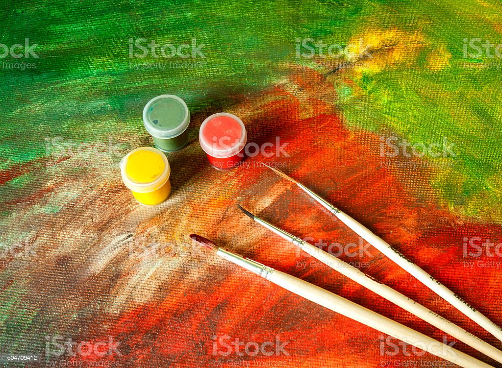 Paint Cans and Paint Brushes on Abstract Paint stock photo