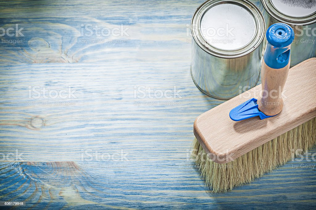 Paint cans brush on wooden board construction concept stock photo