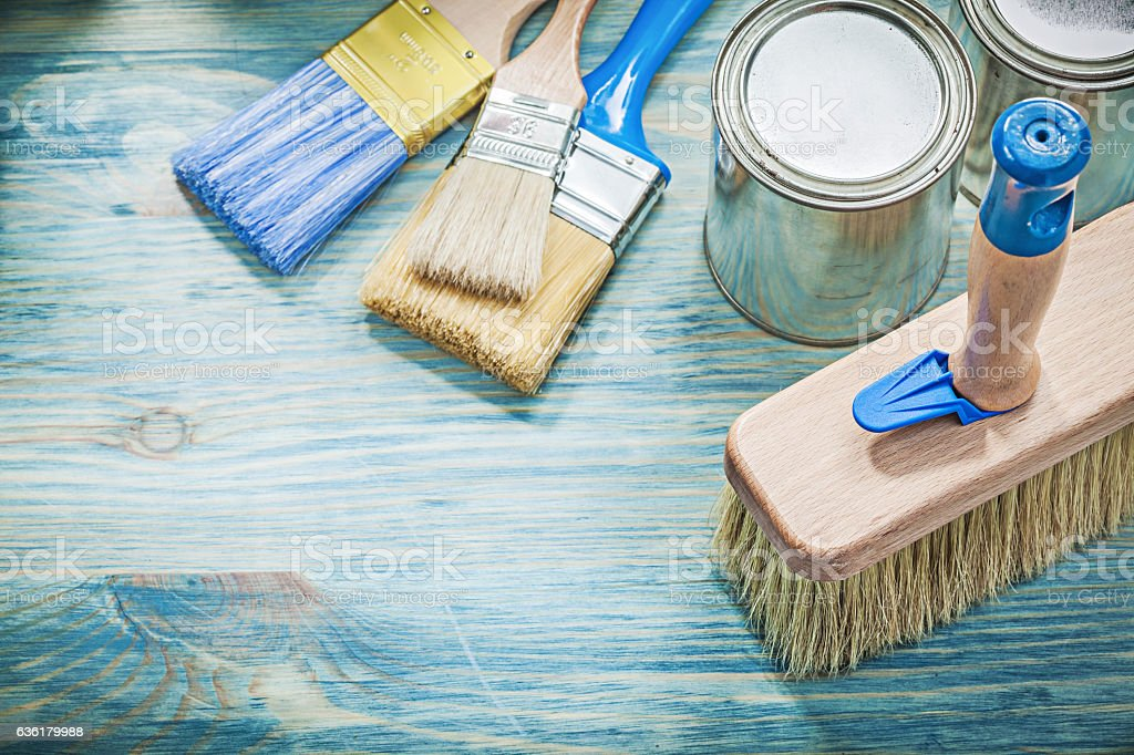 Paint cans brushes on wooden board top view construction concept stock photo