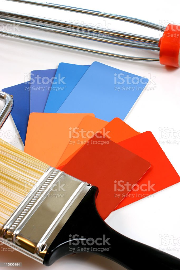 Paint chip samples and brush. Home improvement, DIY. Roller. stock photo