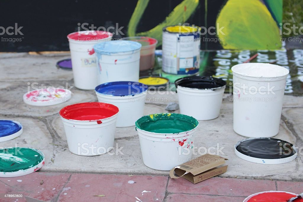 Paint containers on the floor royalty-free stock photo