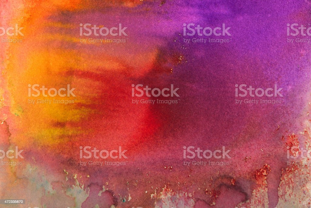 Paint drips of bright watercolors on paper stock photo