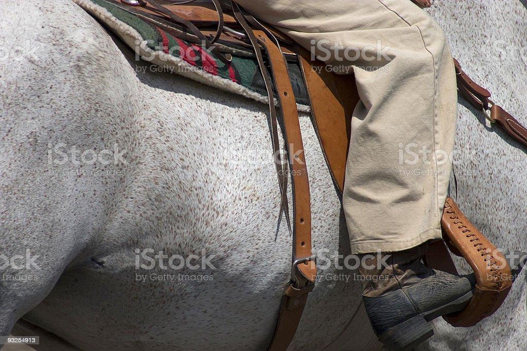 Cheval Pinto et cow-boy détail photo libre de droits