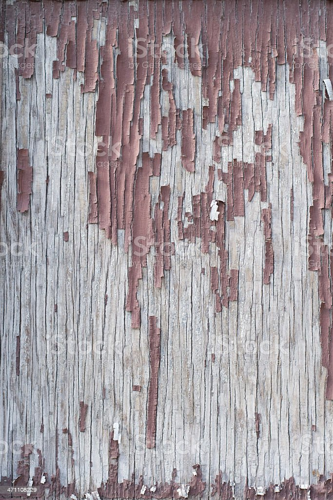 Paint peeling from weathered wood royalty-free stock photo