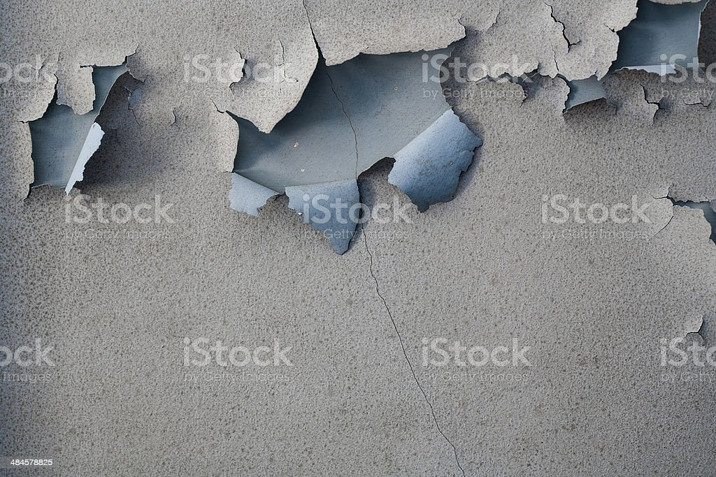 Paint peeling on an old plaster wall stock photo