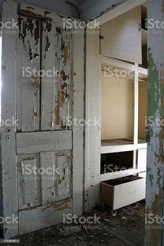 Paint peels off of door in abandoned home royalty-free stock photo