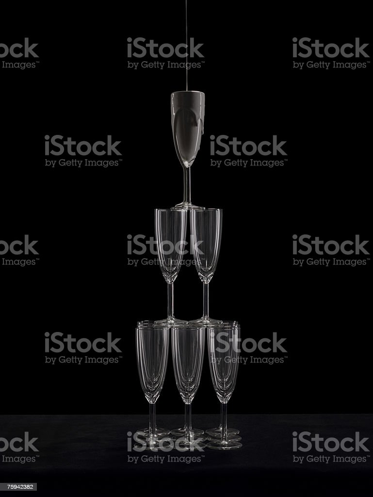 Paint pouring into champagne flutes stock photo