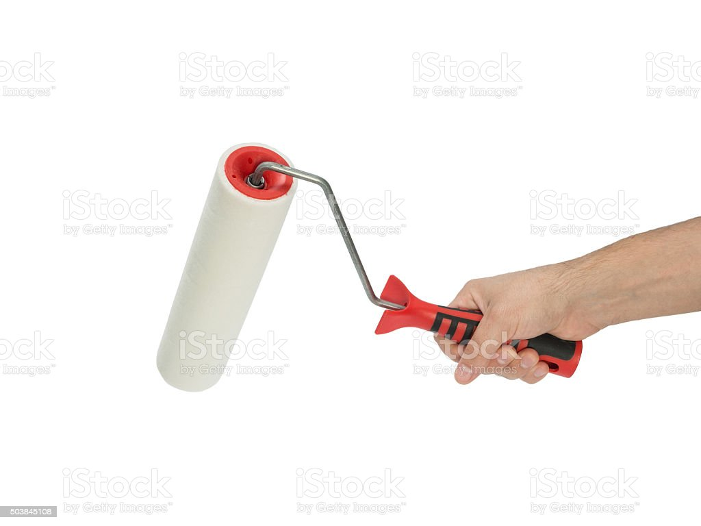 Paint roller in man's hand stock photo
