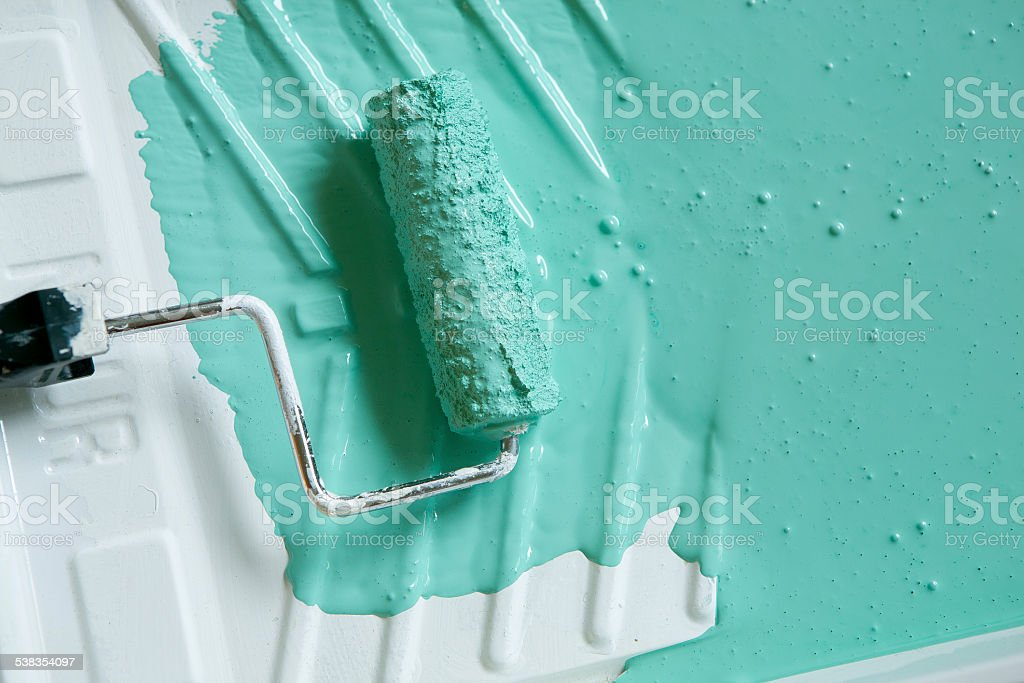Paint roller in tray stock photo