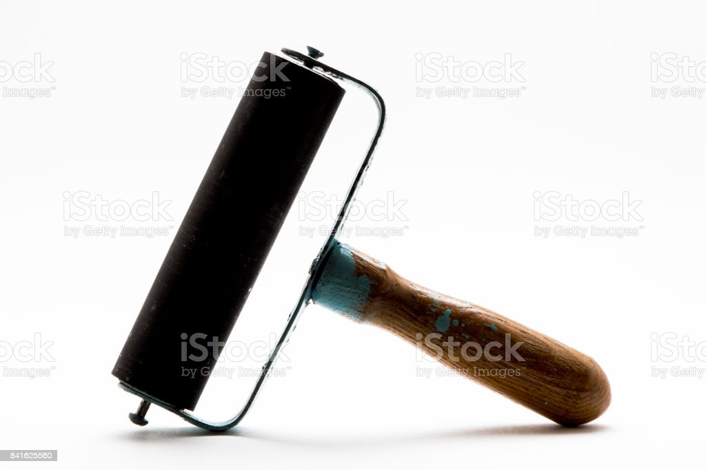 Paint roller on white background stock photo