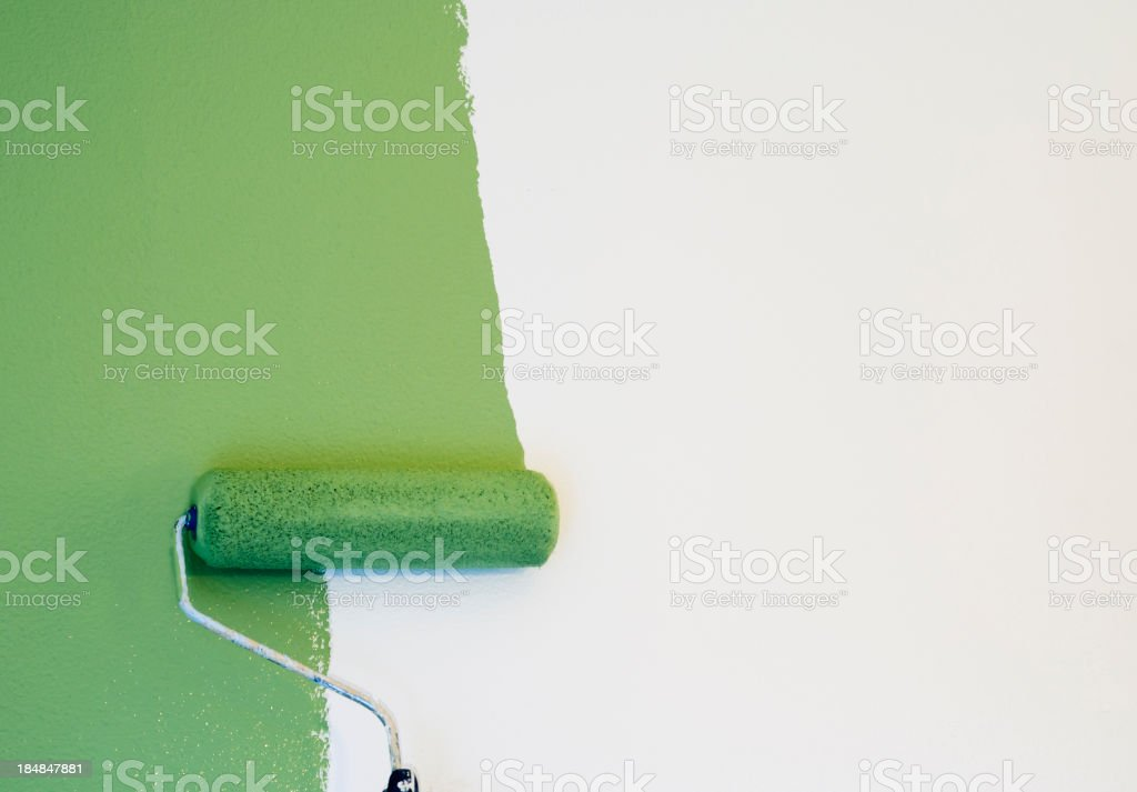 Paint Roller Painting a Wall stock photo