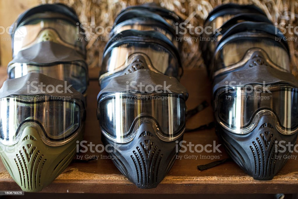 Paintball masks in a row royalty-free stock photo
