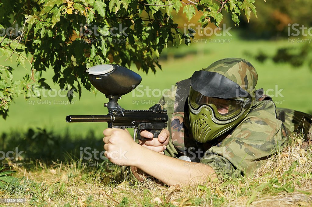 paintball player aiming with marker royalty-free stock photo