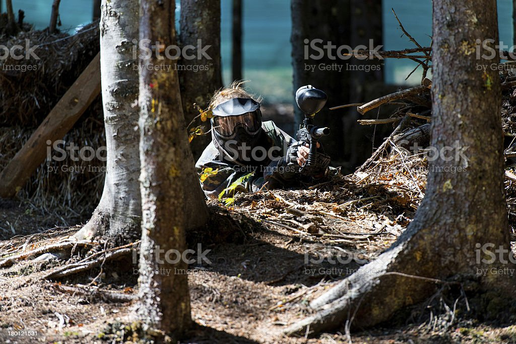 Paintball Player Hide Behind Tree royalty-free stock photo