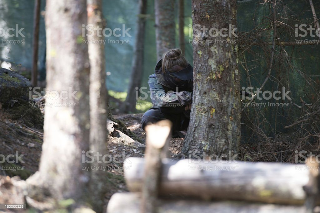 Paintball player Hiding royalty-free stock photo