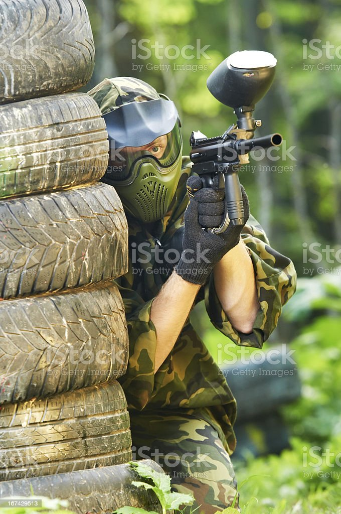 paintball player holding fire royalty-free stock photo