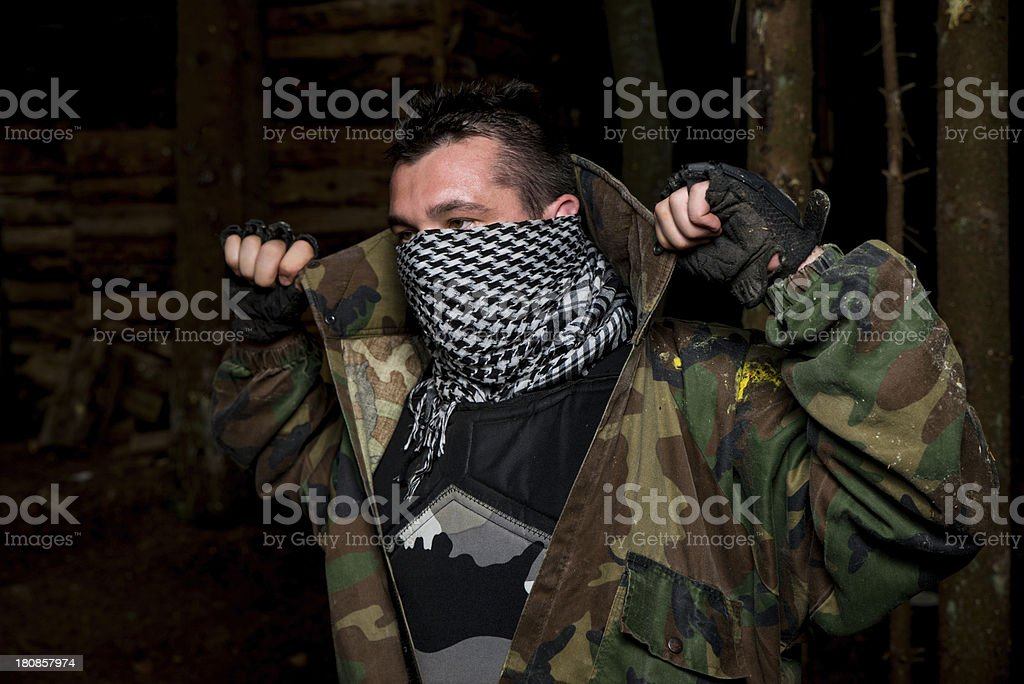 Paintball player preparing for battle royalty-free stock photo