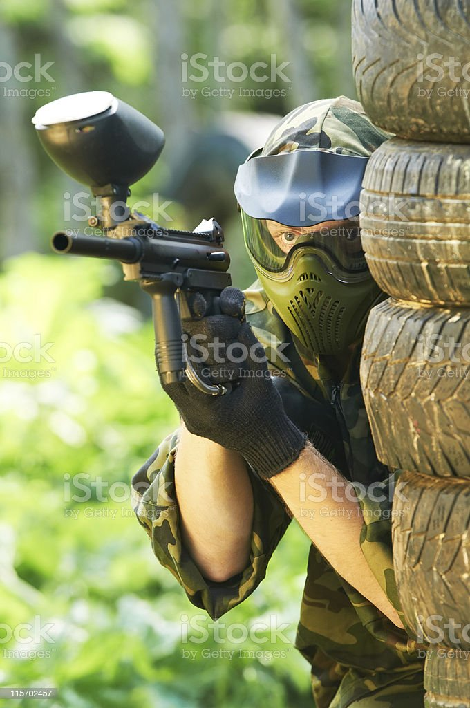 paintball player under cover royalty-free stock photo