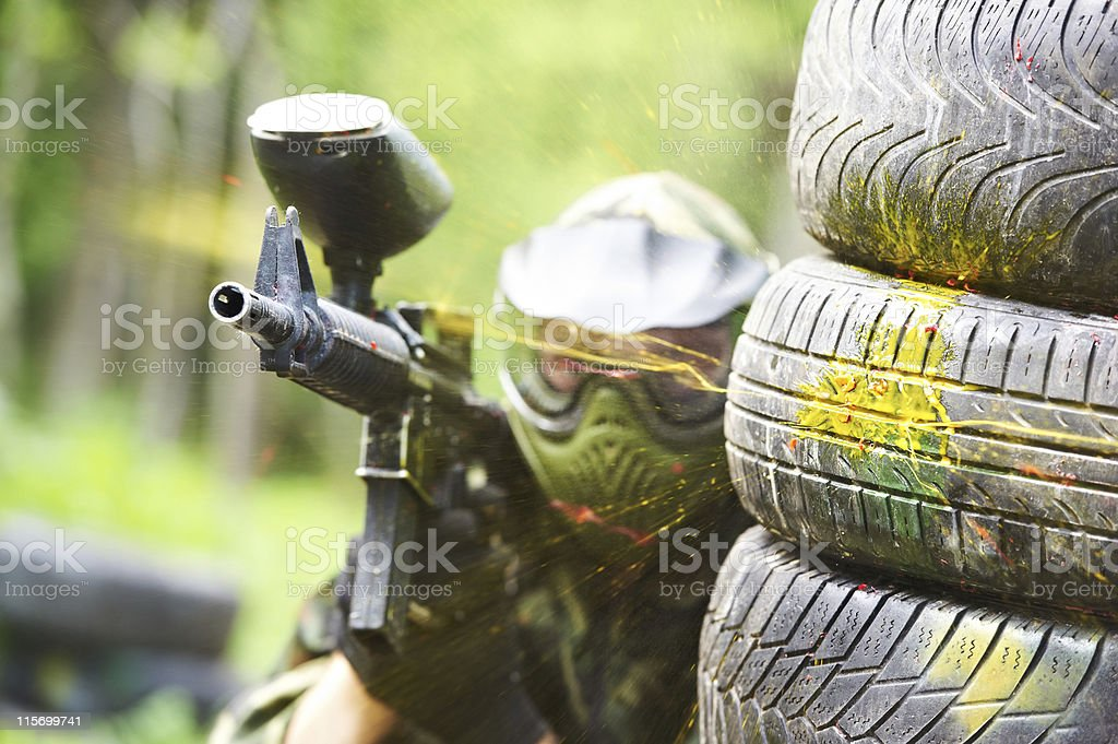 paintball player under gunfire royalty-free stock photo