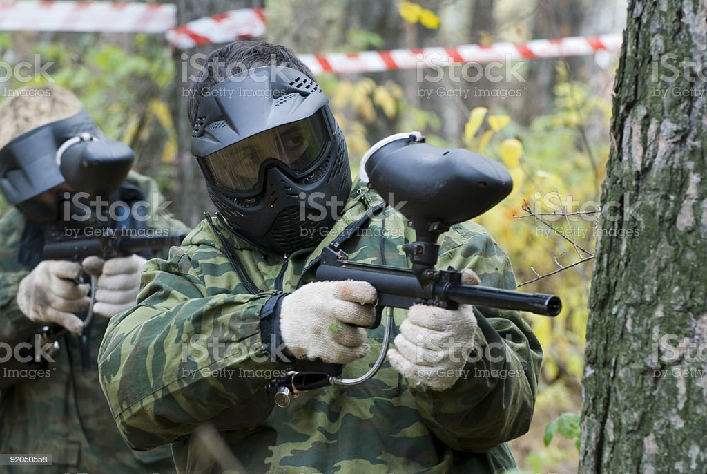 Paintball players having a good game royalty-free stock photo