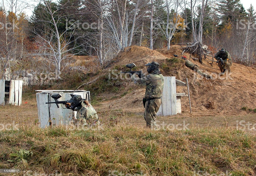 Paintball players in action royalty-free stock photo