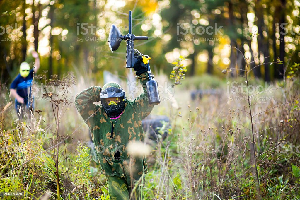 Paintball sport player in protective uniform stock photo