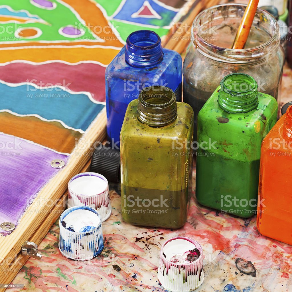 paintbrush and bottles with dyes royalty-free stock photo