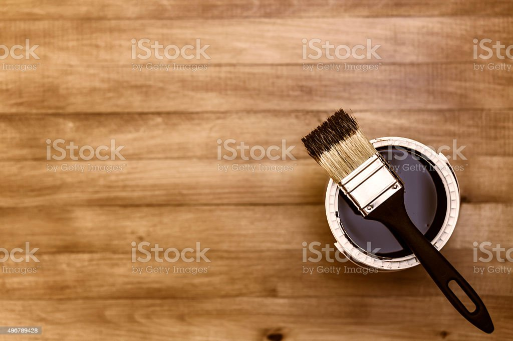 Paintbrush And Paint Can On A Wooden Background stock photo