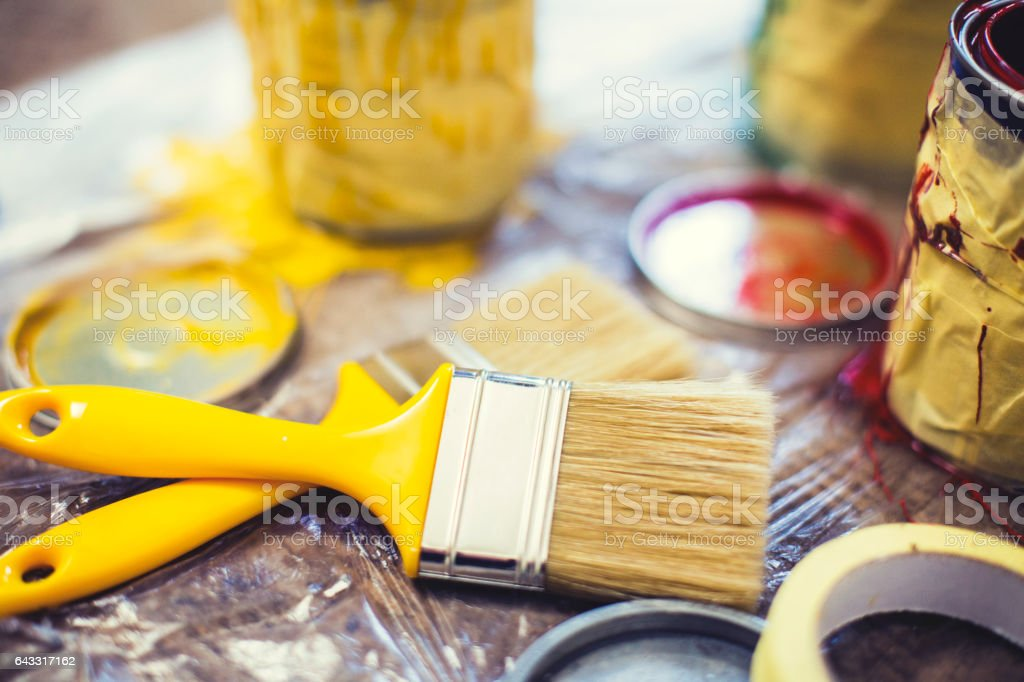 Paintbrush and paint cans stock photo