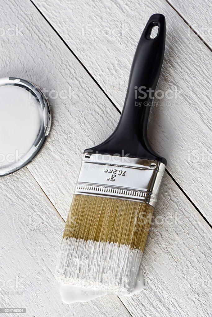 Paintbrush and white paint stock photo