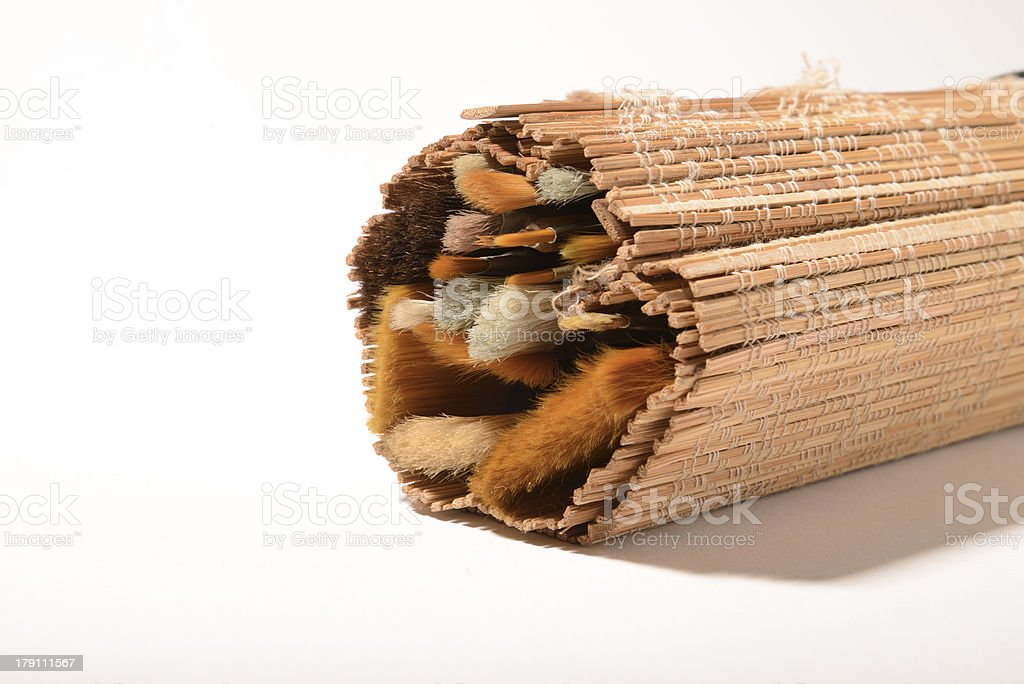 Paintbrush folded in a bamboo sleeve royalty-free stock photo