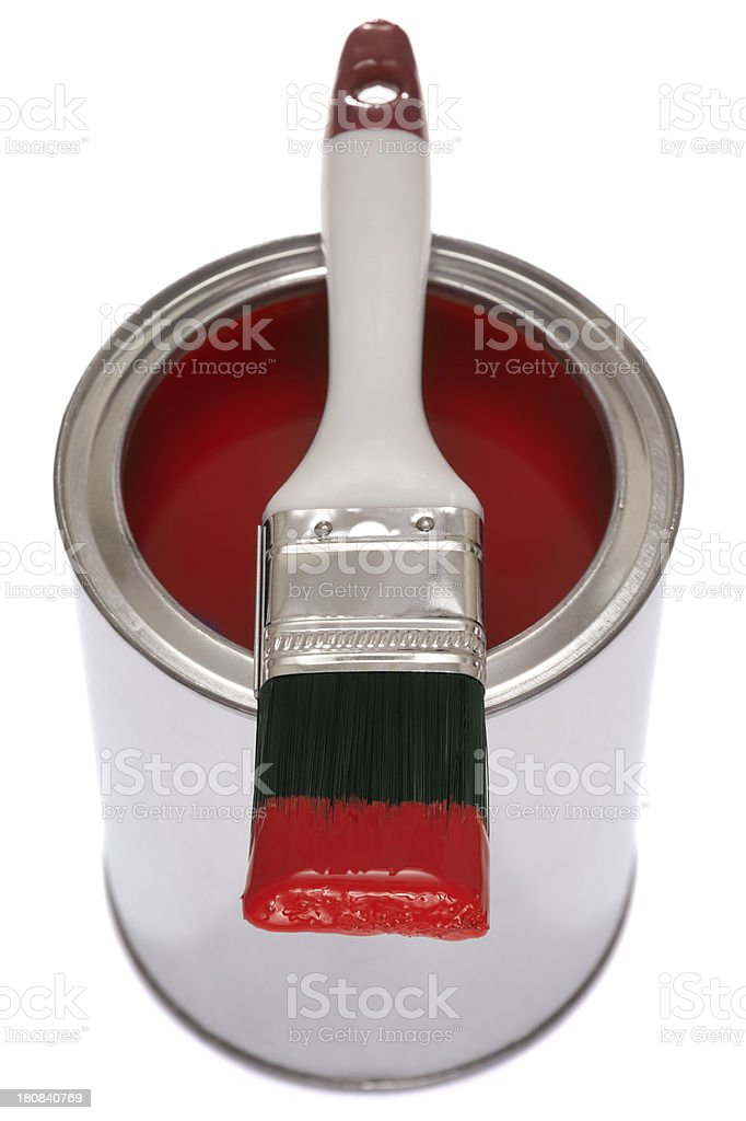 Paintbrush on a tin of red paint royalty-free stock photo