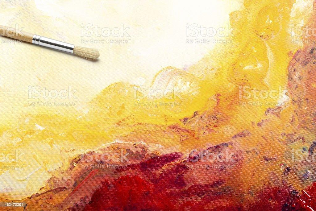 Paintbrush on Artist's canvas stock photo