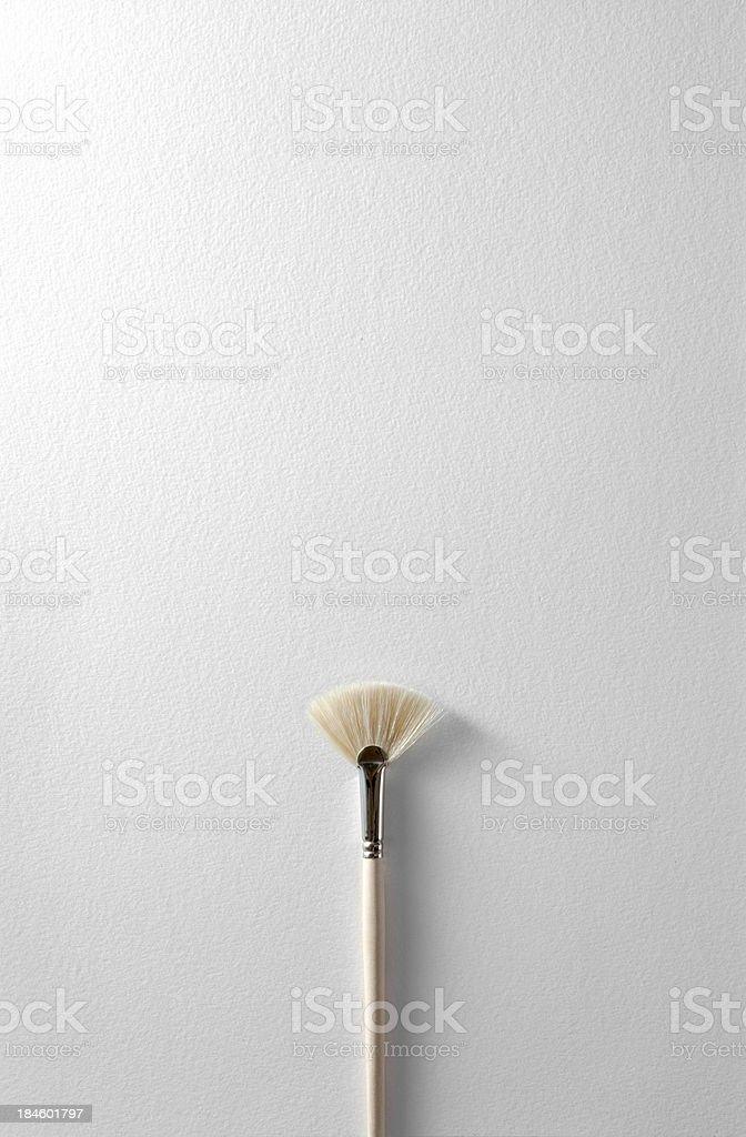 Paintbrush on white paper royalty-free stock photo