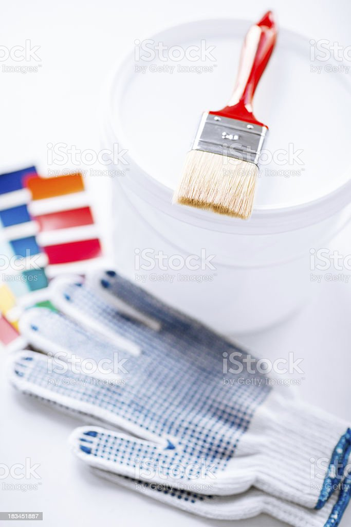 paintbrush, paint pot, gloves and pantone samples royalty-free stock photo