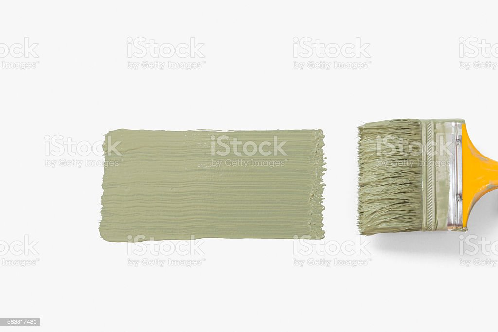 Paintbrush painting wall into green stock photo