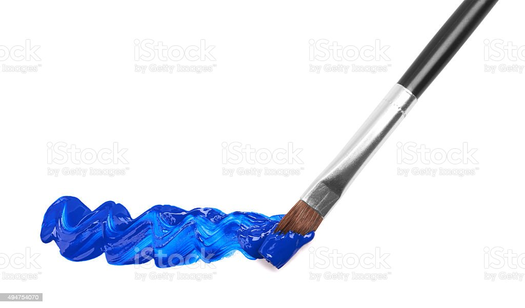 Paintbrush with blue paint stock photo