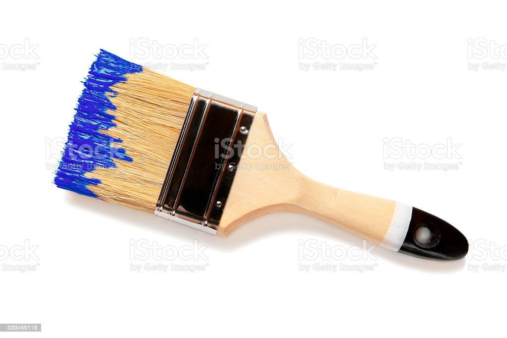 Paintbrush with blue paint (isolated on white) stock photo
